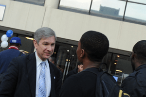 Dr. Becker talks with students on campus