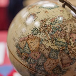 A globe on a desk - Goal 5 - Internationalization
